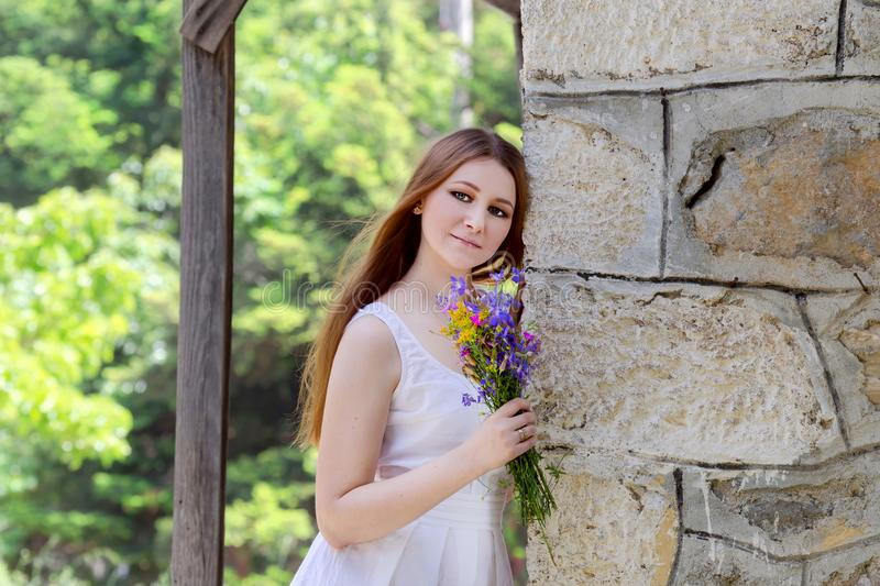 Young woman with wildflowers stock photos
