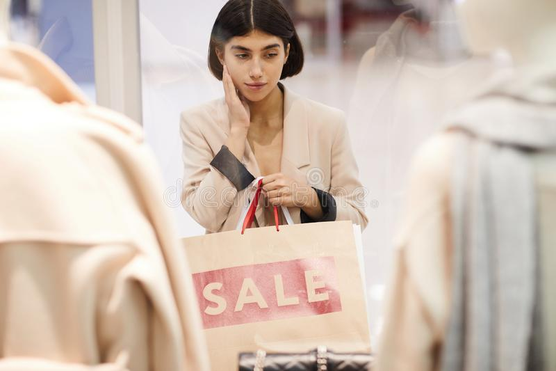 Young Woman Window Shopping stock image