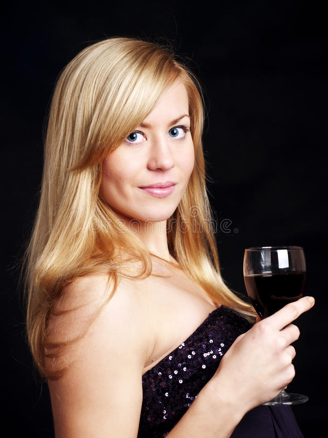Young Woman With Wine Over Dark Royalty Free Stock Image