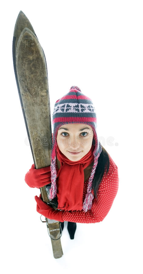 Download Young Woman In Winter Cap Holding Old Ski Stock Photo - Image of skiing, antiquated: 12975854