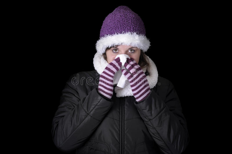 Young woman in winter clothes having a cold royalty free stock photography