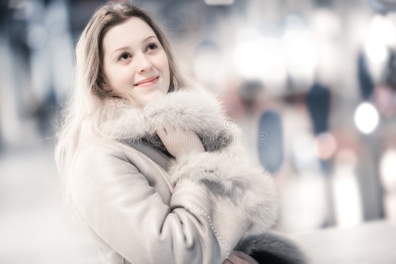 Young woman in winter clothing indoors portrait stock photography