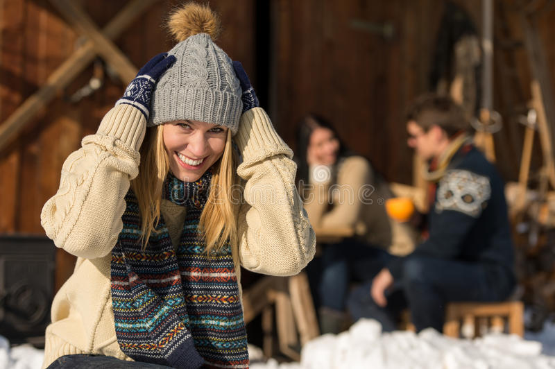 Young woman in winter hat snow cottage royalty free stock photo