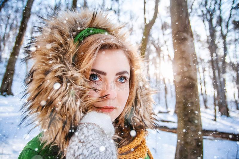 Young woman winter portrait. Close-up portrait of happy girl. Expressing positivity, true brightful emotions royalty free stock image