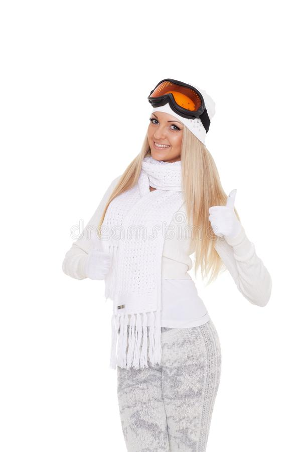 Young woman in winter warm clothes and ski glasses royalty free stock images