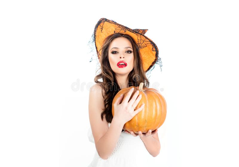 Young woman with witch hat dressed as vampire for Halloween party - isolated on white background. Vampire woman on stock image