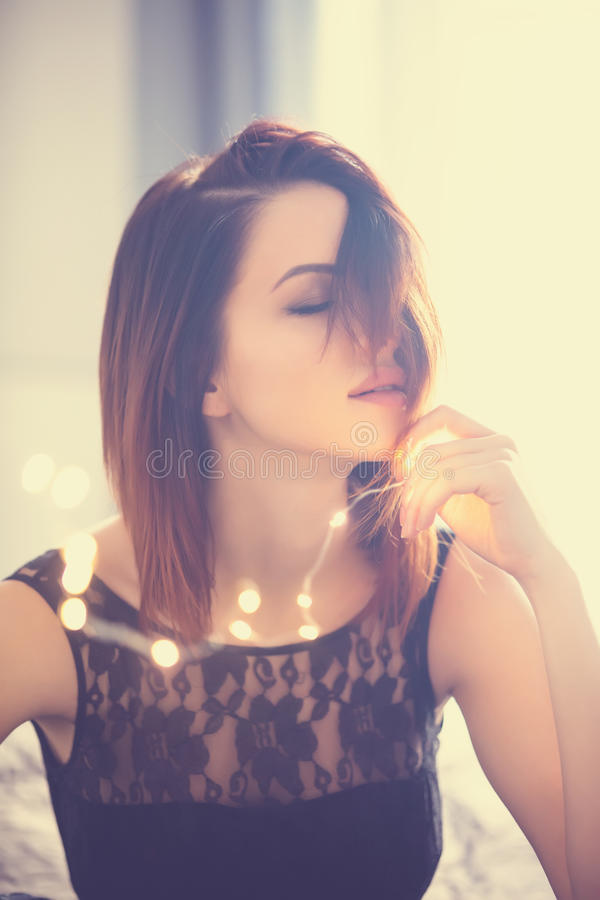 Free Young Woman With Fairy Lights Stock Photography - 82250352