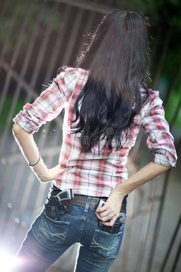 Free Young Woman With Guns Backside View Royalty Free Stock Photo - 11198985