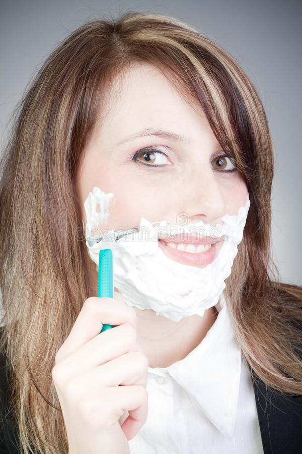 Free Young Woman With Shaver On Her Face Royalty Free Stock Photos - 18924838
