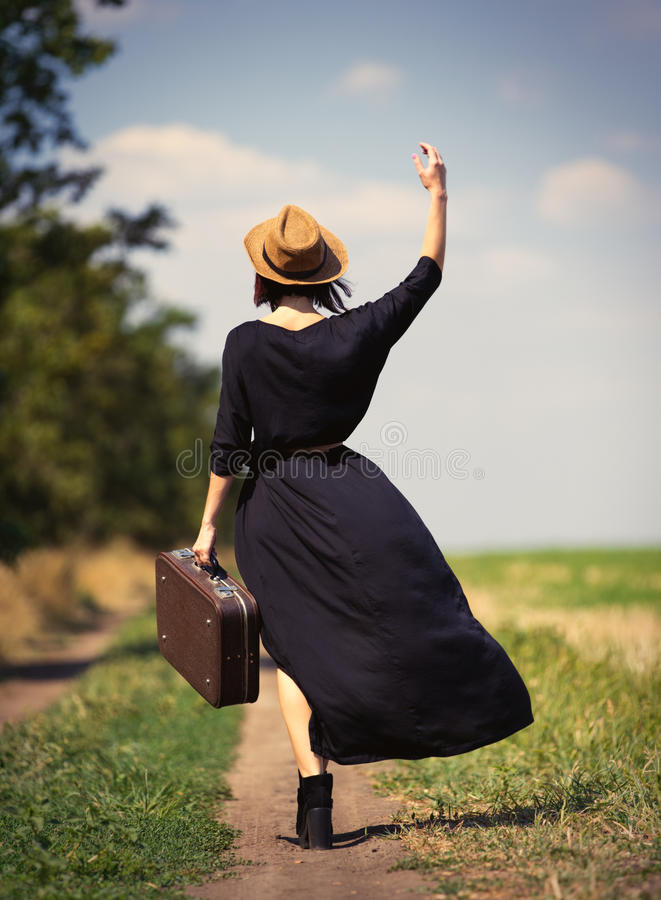 Free Young Woman With Suitcase Royalty Free Stock Image - 75941326