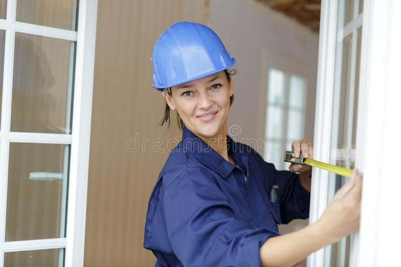 Young woman worker on building site stock photography