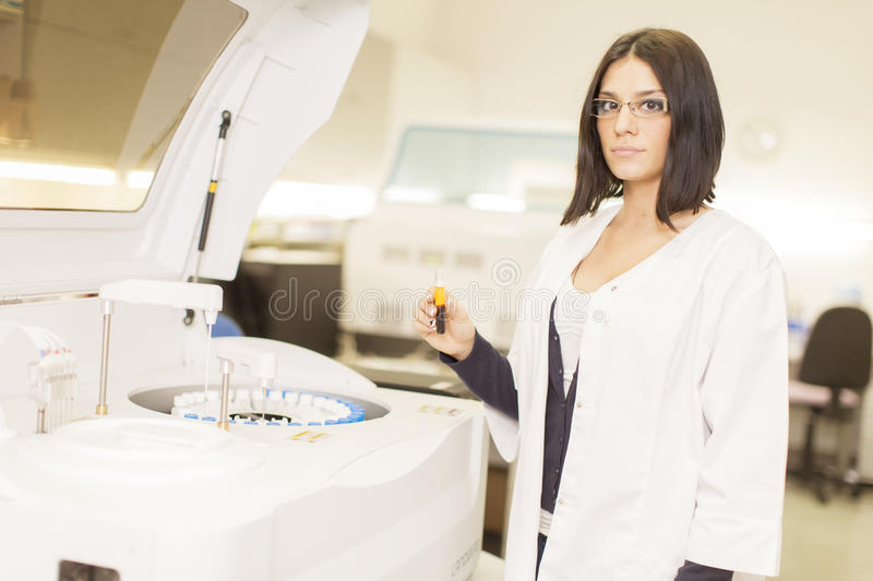 Medical laboratory. Young woman workin in the medical laboratory stock photo