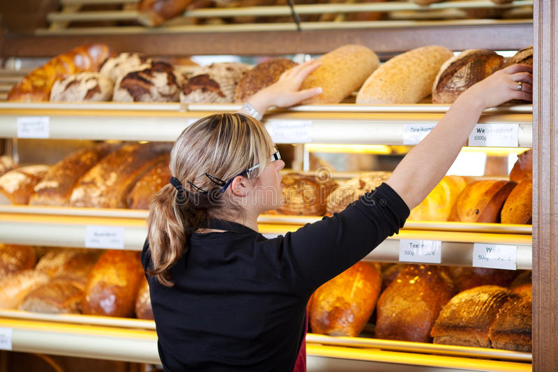 Young woman working in bakery stock photos