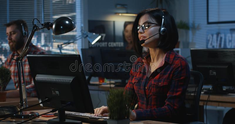 Young woman working at a call center stock photography