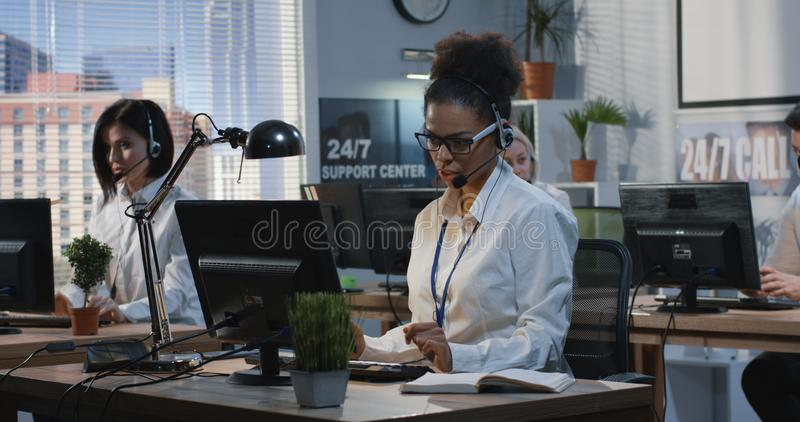 Young woman working at her desk stock photos