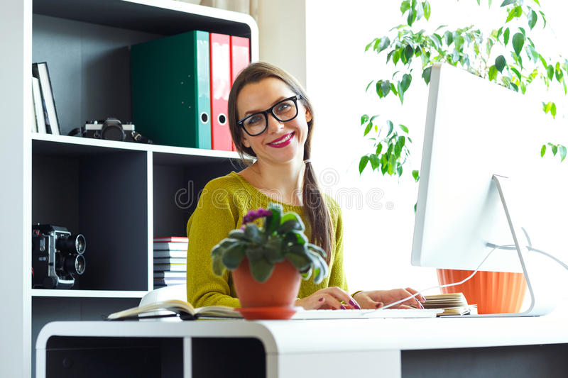 Young woman working from home - modern business concept stock photos