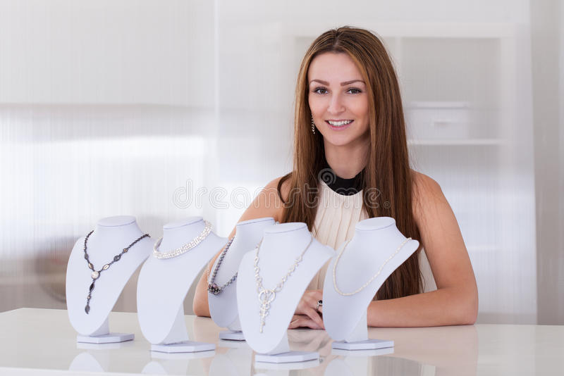 Young Woman Working In Jewelry Shop royalty free stock photo