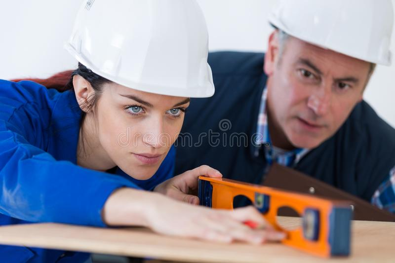 Young woman working with level royalty free stock photos