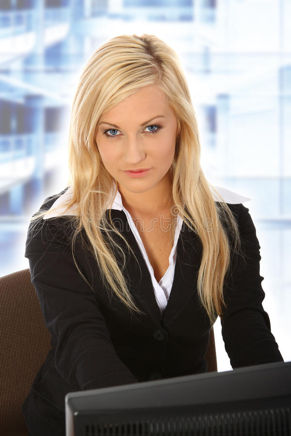 Young woman working in office stock photos