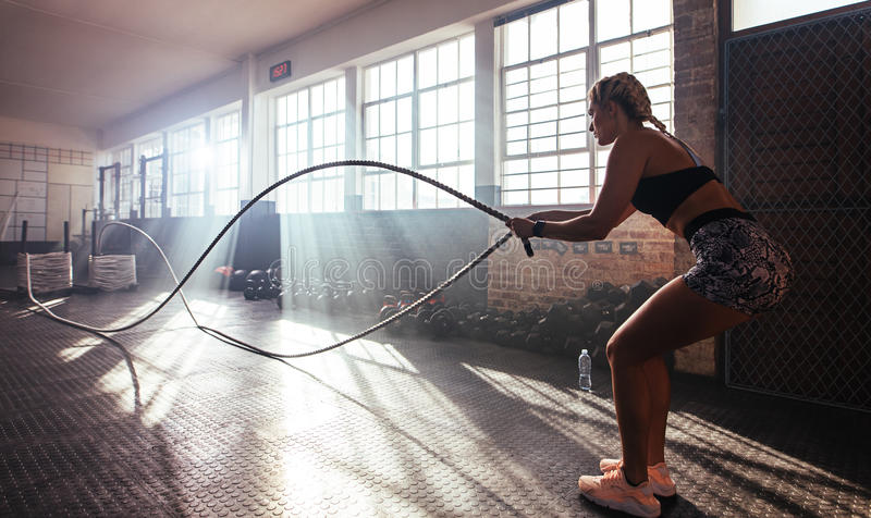 Young woman working out at the gymnasium. royalty free stock photography