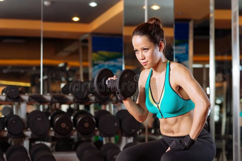 Young woman working out stock image
