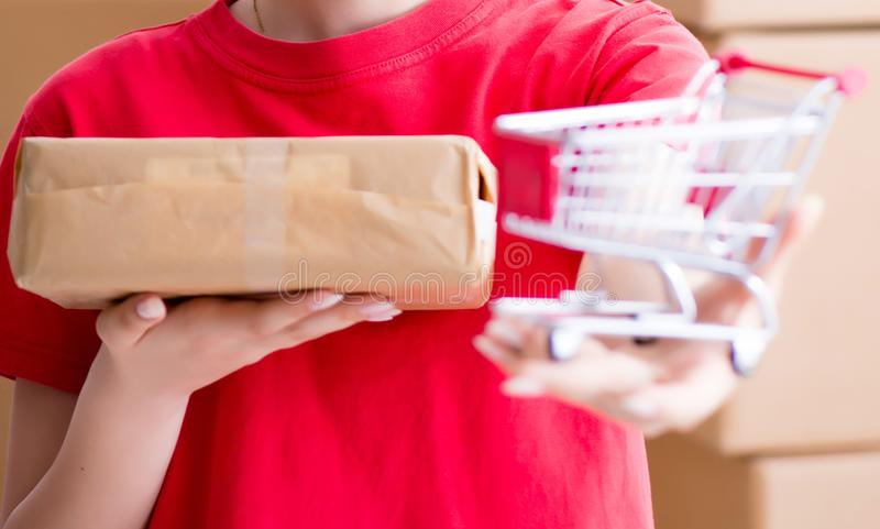 Young woman working in parcel distribution center royalty free stock photos