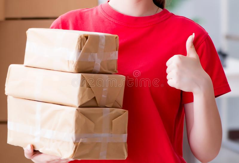 Young woman working in parcel distribution center royalty free stock image