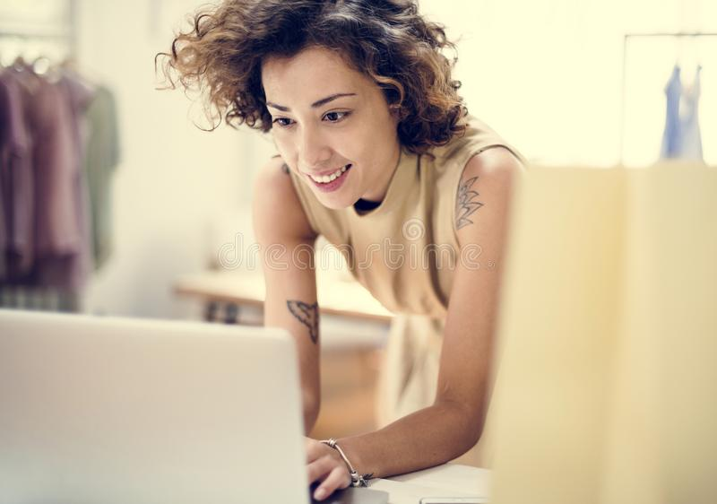 Young woman working on projects stock image