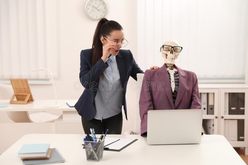 Young woman working with skeleton stock images
