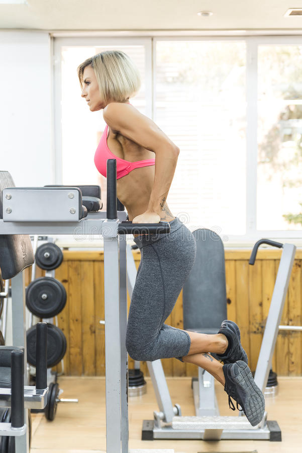 Young woman working triceps exercise at gym stock photos