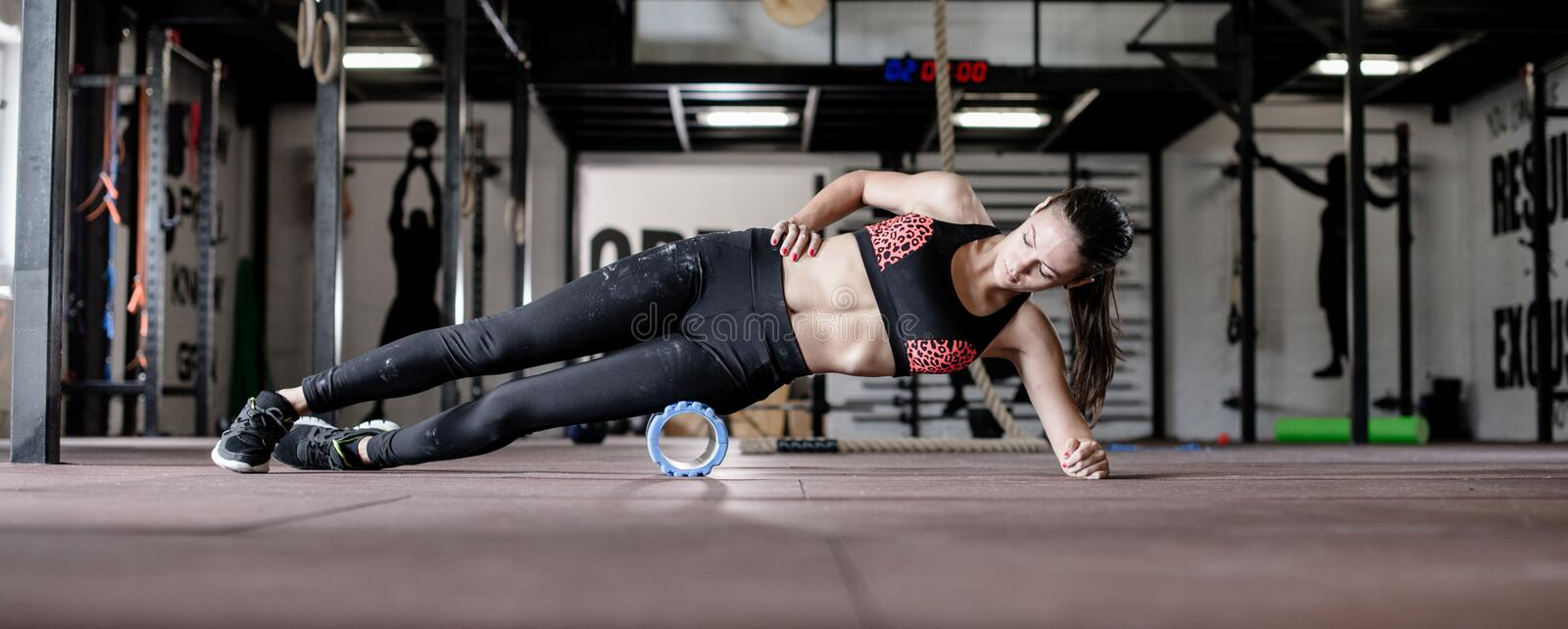Young woman works out on gym floor. Girl works out on gym floor royalty free stock photos