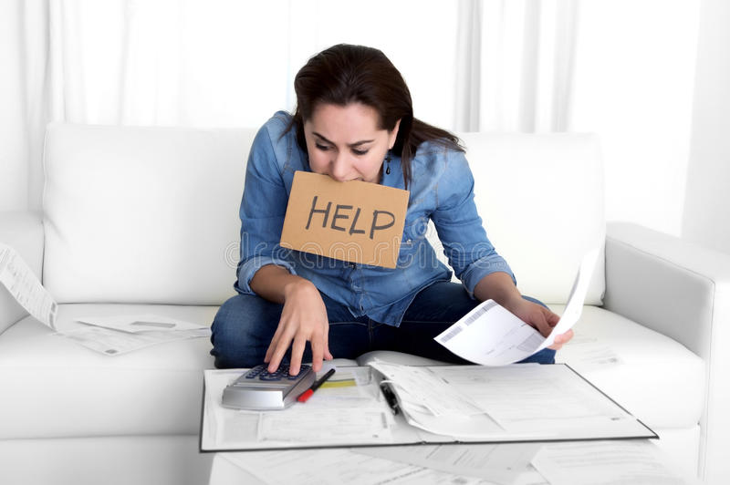 Young woman worried at home in stress accounting desperate in financial problems stock photography