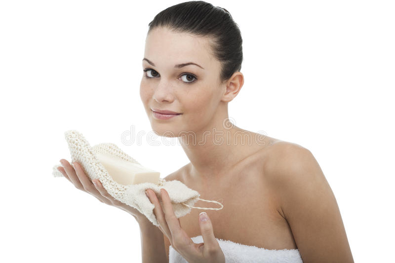 Young woman wrapped in towel stock image
