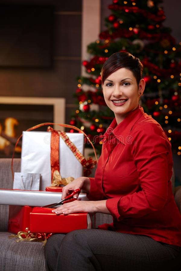 Download Young Woman Wrapping Gifts At Christmas Stock Photo - Image: 21772128