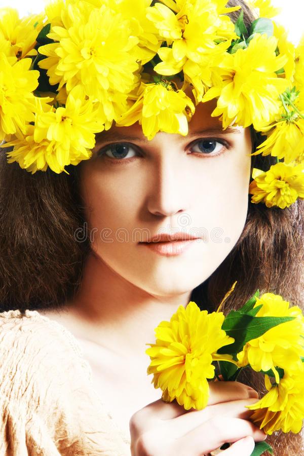 Download Young Woman With Wreath Of Yellow Flowers Stock Photo - Image: 16557646