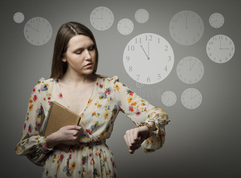 Young woman and wristwatch. 11 p.m. stock photo