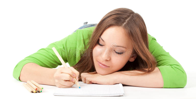 Download Young Woman Writing Or Painting Stock Photo - Image of happy, adult: 18606314