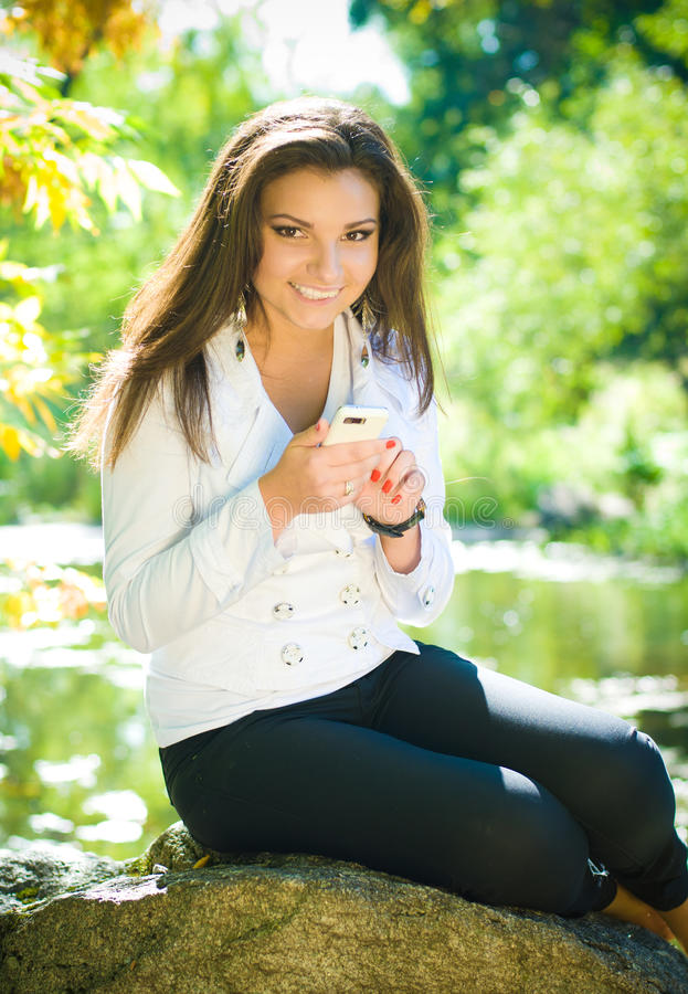 Young Woman Writing Sms Royalty Free Stock Images