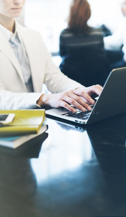 Young woman writing text hands on the open laptop in a cafe on a table with reflection , businesswoman working on comput. Young woman writing text hands on the royalty free stock photography