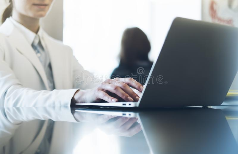 Young woman writing text hands on the open laptop in a cafe on a table with reflection and glare, businesswoman work on comput. Young woman writing text hands on stock photos