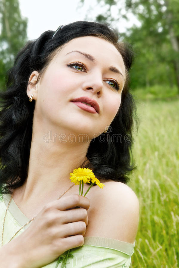 Young woman with yellow wild flowers royalty free stock photo