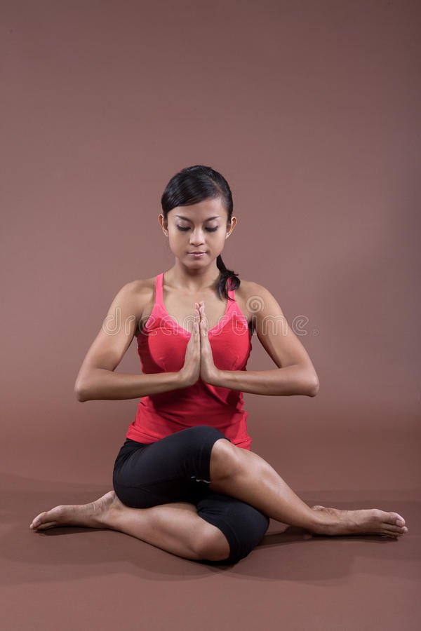 Download Young woman in yoga pose stock photo. Image of limbs - 10576714