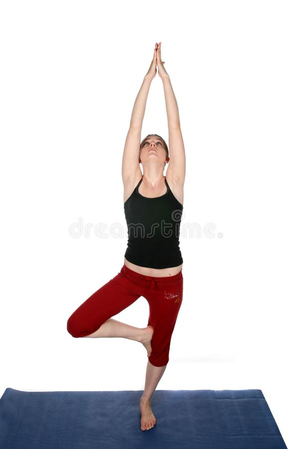Young woman in yoga pose stock photos