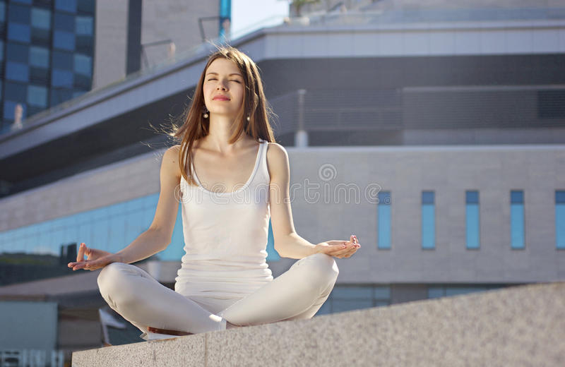 Young woman in yoga pose royalty free stock images