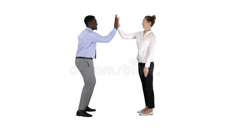 Young woman and young man in formal clothes give high five on white background. royalty free stock image