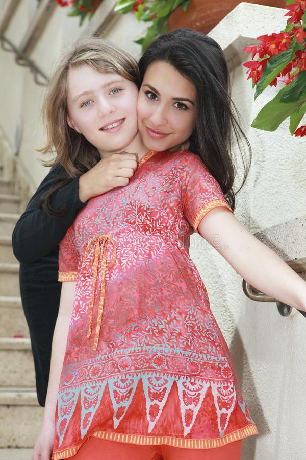 Young Woman and Young Teenager royalty free stock image