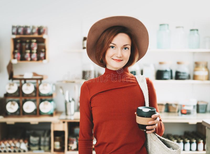 Young woman in zero waste shop royalty free stock photo