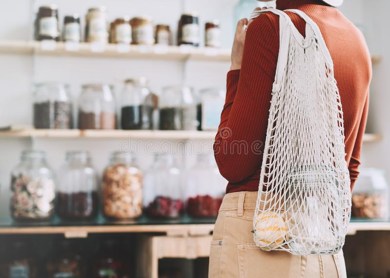 Young woman in zero waste shop or plastic free store royalty free stock image