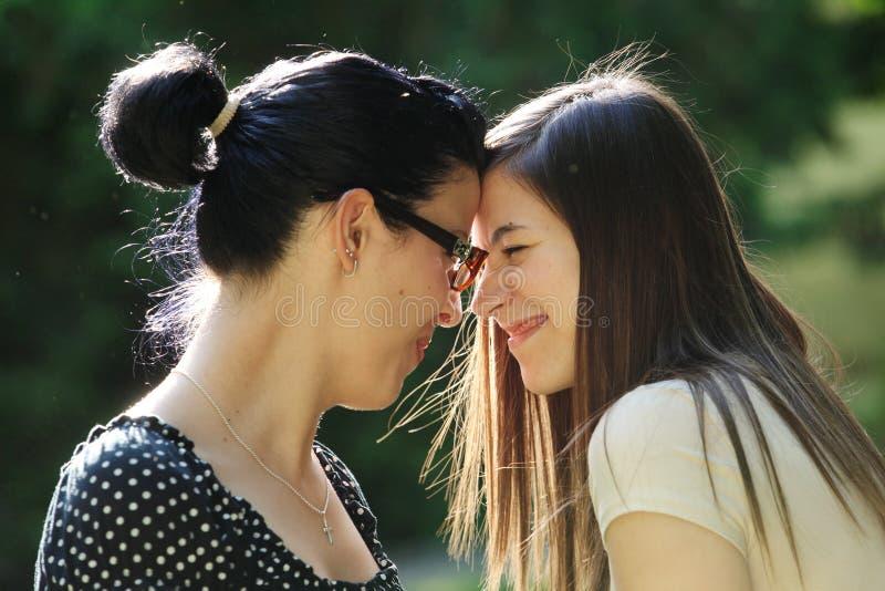 Young women. Two young joyful women outdoor stock images