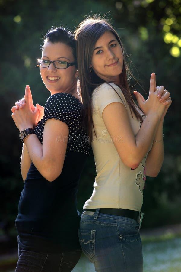 Young women. Two young joyful women outdoor stock photography
